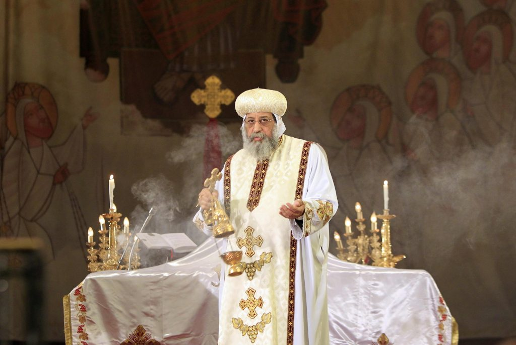 Pope Tawadros II, the 118th Pope of the Coptic Orthodox Church of Alexandria and Patriarch of the See of St. Mark Cathedral, leads mass prayers for the Egyptians beheaded in Libya, at Saint Mark's Coptic Orthodox Cathedral in Cairo, February 17, 2015. Egyptian President Abdel Fattah Al-Sisi called for a United Nations resolution mandating an international coalition to intervene in Libya after Egypt's airforce bombed Islamic State targets there. Egypt directly intervened for the first time in the conflict in neighbouring Libya on Monday after an Islamic State group in the country released a video showing the beheading of 21 Egyptian Christians. REUTERS/Mohamed Abd El Ghany (EGYPT - Tags: POLITICS RELIGION CONFLICT CIVIL UNREST)
